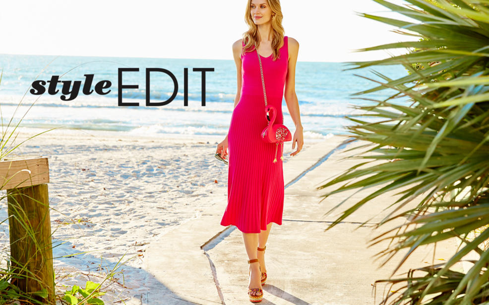 Style Edit. Woman in a red dress on the beach.